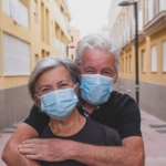 Adult couple wearing masks
