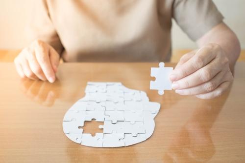 Elderly main with brain puzzle