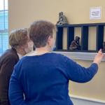 Two Women viewing artwork